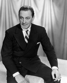 Actor John Barrymore, the grandfather of actress Drew Barrymore slicks his hair back for a portrait.