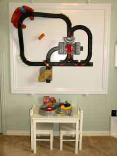 sooo smart. saves storage space- just take it off wall to play with it! #kids #toys #railroads