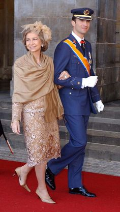 Queen Sofía of Spain & her son Prince Felipe, now King Felipe VI | Guests walked from the Royal Palace to the Nieuwe Kerk Church for the wedding of Crown Prince Willem Alexander of The Netherlands & Máxima Zorreguieta, from Argentina