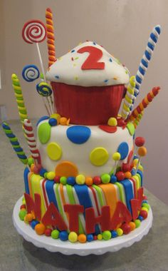 Candy Birthday Cake - I made this for my son's 2nd birthday.  Everything is done in fondant including suckers.  I don't love how it turned out(new fondant recipe) but he loved it!  Not the best photo- sorry!  I had to do a little photoshop on the cupcake where my son decided he couldn't wait and poked it.