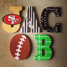 New Baby Boy Nursery Sports Football Wooden Letters Ideas Painting Wooden Letters, Painted Letters, Hand Painted, Hanging Letters, Diy Letters, Baby Girl Crochet Blanket, Character Letters, Baby First Halloween, Murals For Kids