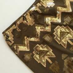 """NWT Bongo Sequin Mini NWT Bongo Sequin Mini...Aztec print stretch mini skirt covered front and back with sequins: gold, bronze, rose gold...gorgeous! Fully lined! Length 14"""". Retail $34.  ***price is firm*** BONGO Skirts Mini"""