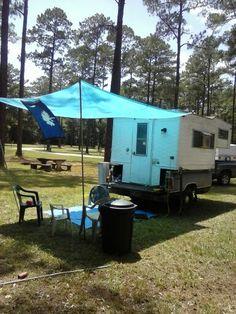 Slide in truck camper on bed pick-up/ trailer.