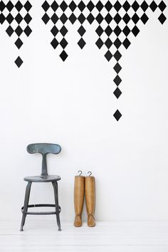 Shapes out of vinyl, attach to wall and peel away when change is needed.
