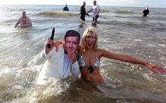 Charity swimmer Sarah Green takes a dip in the sea with James Bond