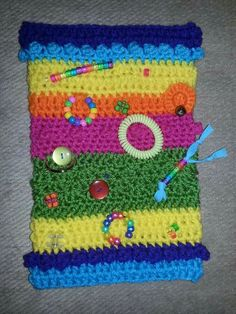 Twiddle muff for dementia patients. Free pattern on Ravelry.
