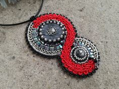 Bead embroidery medal with Picasso jasper, swarovski crystals and soutache