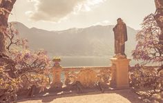Villa Balbianello Pointing Statue  The statue looks over the most lovely vista at Villa Balbianello and gestures; to the surroundings and almost to the heavens. He seems to say, perhaps here, they are the same. Italy is a long way to travel to see the view of an old statue. I stood in this spot, sat in this spot for hours, the warm sun penetrating the biting cold April Lake Como wind. I thought of all places I have been and seen; I agreed with the statue.