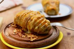Scalloped Hasselback Potatoes  slice the potato and insert alternating slices of cubed butter and cheese. drizzle with olive oil, salt, pepper and back. top with cream and cheddar cheese and enjoy!