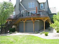 A larger deck off the back of a home.