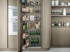 XXL VOL. 3 - Optional pull-out tall unit fully fitted out inside with shelves in steel wire fixed directly onto the door. Design Kitchen, Bathroom Medicine Cabinet, Liquor Cabinet, Wire, The Unit, Shelves, Doors, Steel, Storage