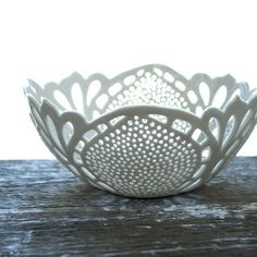 Simple Lace Bowl by isabelleabramson on Etsy This gorgeous white porcelain bowl with intricate cutout lace pattern is handcrafted by Issabelle Bramson.