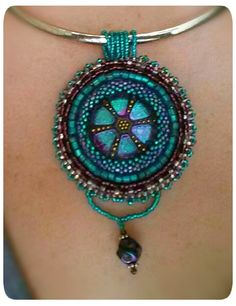 Love this pendant!  Bead embroidery with Czech glass button.