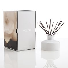 The Voluspa Seasons Fleur De Fete 9.5 oz fragrant oil diffuser is presented in an elegant coloured glass bottle and leaves your room scented with a blend of blend Calla Lilly, Crème Roses, White Narcissus, Tuberose Absolute & Butter Cream Cake - yummy!  Expect to Pay:  £55.00