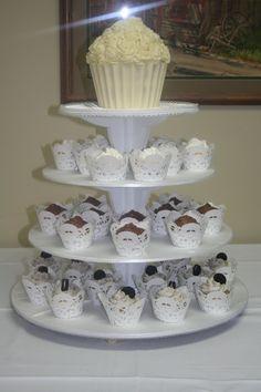 I like the idea of the large cupcake top. Wedding cupcake tower.