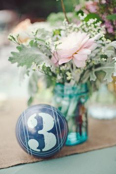 Bocce ball table numbers  Photography by jnicholsphoto.com, Wedding Coordination by threeapplesevents.com, Floral Design by zinniaandcompany.com