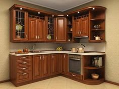Corner Kitchen Set In Rich Wood And Marble #Kitchendesign #Kitchendesignideas #Kitchens #Kitchenlayout