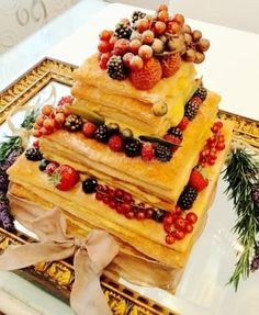 A Traditional Italian Wedding Cake With Designers Twist Served On An Antique Mirror For Extra Impact