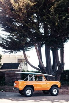vintage orange bronco + surf board #suv