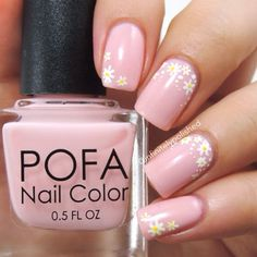 Pink nails with small daisies as accent (by @infinitelypolished).