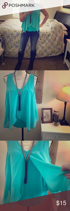 BCX Turquoise Top I love this style of top that I have it in 3 colors. To make space in my closet, I'm selling one of them. This top has a cotton bottom and open cutout top made of rayon. The cut of the rayon is so flattering-its light and comfortable. Pair this top with a cute pair of skinny jeans, a long necklace and a cardigan or blazer, boots or ballet flats, and you're  set. BCX Tops Blouses