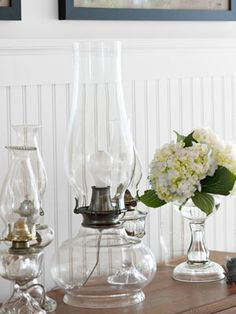 A collection of 19th-century patterned glass oil lamps keep company with a new version wired for electric light. With the help of a rewiring kit, updating a vintage oil lamp is not so complicated. Now that's a bright idea.