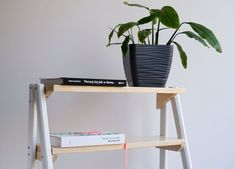 I needed a small shelves for some books and plants. I also wanted some table top near my armchair. So... there it is, simple ladder shelf combined with a coffee table.I've used old wood for legs and some spruce wood for the shelves. The latter was actually a mistake of me - spruce is very soft and not suitable for shelves IMO. Anyway, I've covered it with acrylic lackquer and it's fine... for now :)It's 125 cm heigh and 55 cm wide.Final cost was quite low and I think it's around $15Sketch first Cube Storage Shelves, Small Shelves, Making A Compost Bin, Simple Bed Frame, Oak Dining Sets, Old Bookcase, Diy Ladder, Epoxy Resin Table, Diy Planter Box