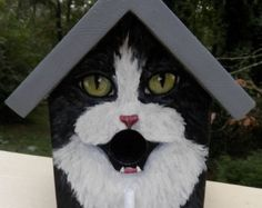 Birdhouse. This bird house is a SAMPLE of a grey tuxedo cat handpainted with a black roof. Great gift for people who love cats! Various cat breeds or colors may be custom ordered. **When placing an order, please specify whether or not you need it to be shipped by a certain date.  **If you would like to order this as a gift, please let me know and I will not include a receipt in the package. You may also request a note to the recipient to be included.  Hand painted wood with acrylics and…