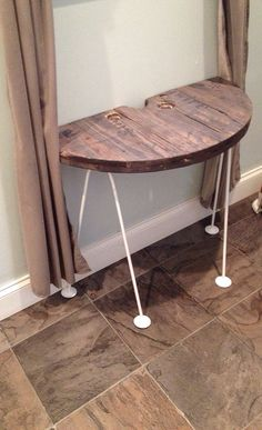Recycled cable spool table on Etsy, $75.00. Interesting contrast between the heavy spool end and the hairpin legs.