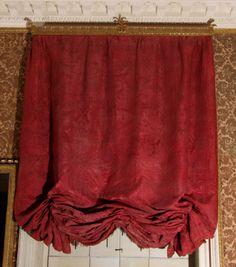 One of five 18th Century original red silk damask festoon curtains (repaired by Lady Meade-Fetherstonhaugh). Associated with 18th Century pelmets NT/UPP/F/129a-e. (NT/UPP/T/87a, c, d, and e are others in set). National Trust Inventory Number 138451.2