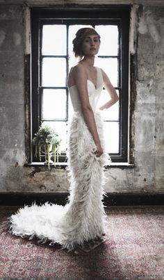 Wedding Party - http://weddingpartyblog.com/2012/12/13/daring-and-demure-brides-with-one-shoulder-wedding-dresses-to-die-for/