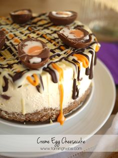 Creme Egg Cheesecake | The gooiest, most delicious Easter dessert you will find this year! Stuffed full of Cadbury's Creme (Cream) Eggs but light and creamy.. You need this in your life! http://www.tamingtwins.com
