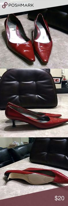 Bandolino shoes This is a pair of red palent leather pump in used condition there is a small black scratch on the side of the shoes A Pea in the Pod Shoes Heels