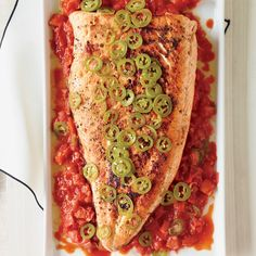 Grilled Salmon with Melted Tomatoes :: Jalapeños not only garnish this sweet-smoky grilled salmon but also infuse the oil used to sauté the tomatoes.  Bryan Caswell: Grilling Fish   ...