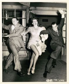 Phil Silvers, Rita Hayworth, and Gene Kelly having lots of fun rehearsing for Make Way for Tomorrow.