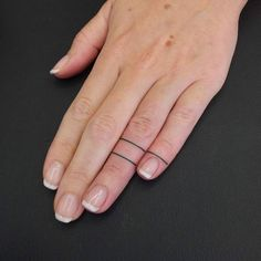 Matching hand poked lines on the left fingers.