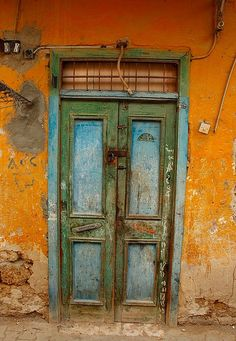 Weathered blue and green door. Egypt