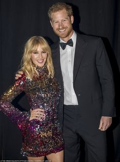 Dazzling: Prince Harry poses with his arms around Kylie Minogue as the pair attend the Att...
