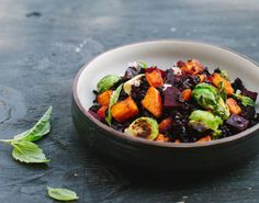 Black Bowl Filled with an Autumn Salad of Black rice, Roasted Butternut Squash, Beets and Brussels Sprouts