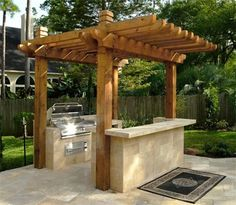A good one with a pergola.  I like that it's open on both ends -- but I wonder if having the barbecue next to the house wall would be a good idea?