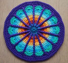 Stunning colours and design in the Spoke Mandala by Marinke Slump (Winkie of A Creative Being). Photo pictured here via Ravelry. Link goes to free pattern on her site.
