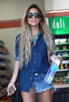 'Gimmie Shelter' actress Vanessa Hudgens stops to pick up some water while showing off her tones legs in short shorts and gladiator sandals in Los Angeles, California on May 23, 2014.