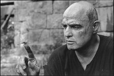 Marlon Brando fascinated by a dragonfly, Apocalypse Now, Pagsanjan, Philippines, 1976 (Shot by Mary Ellen Mark)