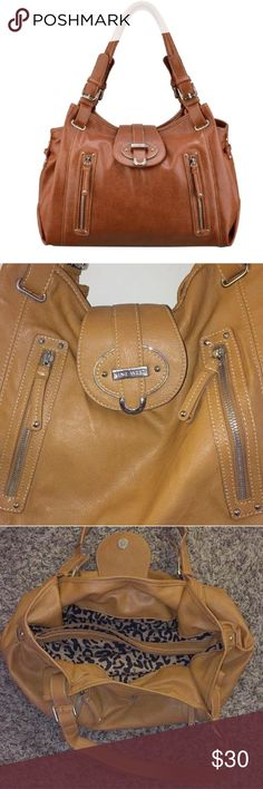 """Zipster Satchel (Tobacco Colored) This satchel is extremely spacious and features 2 exterior pockets, and 4 interior pockets (2 zipped and 2 small). The largest zippered interior pocket is big enough to fit a tablet inside: pocket measures 12"""" long and 7.5"""" tall (see photo; iPad not for sale)! A magnetic snap is used to close the main body of the purse.  *Ships the next day* Nine West Bags Satchels"""