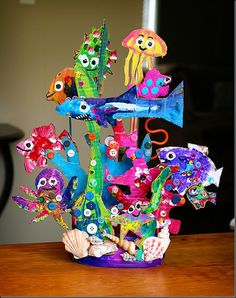 sharpie drawings cut out of cardboard, fingerpaints, buttons & shells = collaborative coral reef