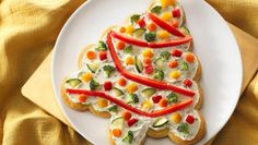 "For the ultimate appetizer ""wow,"" serve this crescent tree topped with cream cheese and garnished with veggie garland and ornaments.  Holiday decorating never tasted so good!"