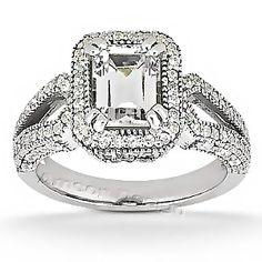 This emerald-cut engagement ring features a plethora of sparkling round-cut diamonds on the white gold ring band. The center emerald cut diamond is Diamond Rings For Sale, Diamond Wedding Rings, Diamond Engagement Rings, Wedding Band, Wedding Venues, Bling Bling, Emerald Cut Diamonds, Diamond Cuts, Big Diamonds