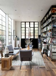 Living room with black door and lots of books