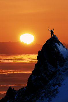 Climber Standing Atop Peak At Sunset Ak Photograph