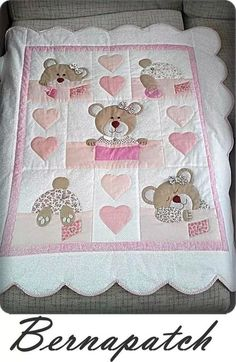 Cute pink little girl's quilt with teddy bears.